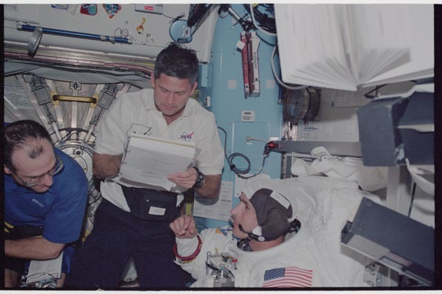 STS113-340-027 - STS-113 - Herrington, Lockhart and Pettit during STS-113 EVA 2 EMU don in Quest A/L