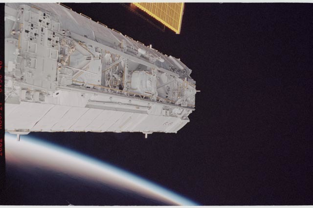 STS113-344-004 - STS-113 - P1 truss backdropped against Earth's limb with SA visible during STS-113
