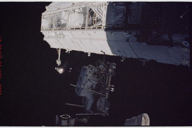 STS113-344-010 - STS-113 - STS-113 EVA 2 transfer / relocation of CETA cart to S1 truss