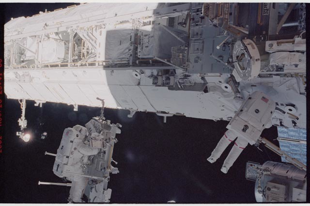 STS113-344-014 - STS-113 - STS-113 EVA 2 transfer / relocation of CETA cart to S1 truss