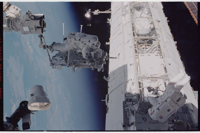STS113-344-016 - STS-113 - STS-113 EVA 2 transfer / relocation of CETA cart to S1 truss
