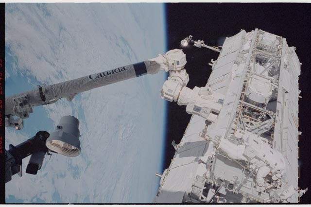 STS113-344-019 - STS-113 - STS-113 EVA 2 transfer / relocation of CETA cart to S1 truss