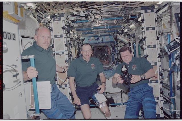 STS113-352-010 - STS-113 - Expedition Six crew pose in the Destiny U.S. Lab during STS-113