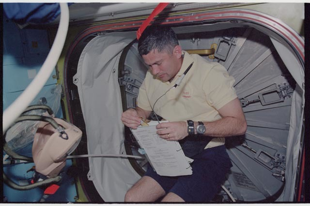 STS113-360-010 - STS-113 - Lockhart reads a checklist in preparation for STS-113 EVA 1