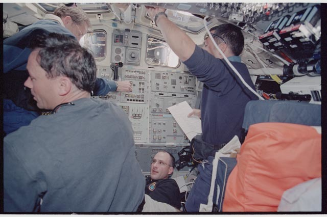 STS113-361-025 - STS-113 - STS-113 and EXP Six crew on Endeavour's AFD during rendezvous and docking with ISS