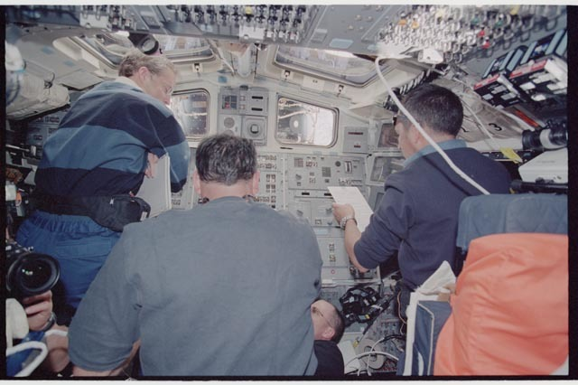STS113-361-030 - STS-113 - STS-113 and EXP Six crew on Endeavour's AFD during rendezvous and docking with ISS