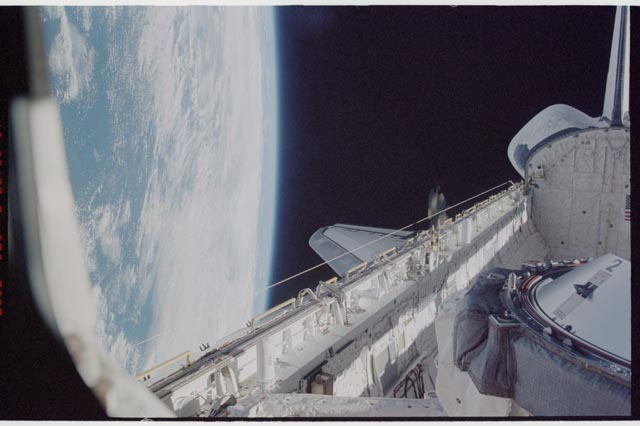 STS113-370-003 - STS-113 - View of Endeavour's STBD longeron and MEPSI deploy during STS-113