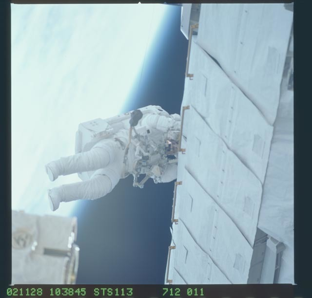 STS113-712-011 - STS-113 - Herrington works at P1 truss during STS-113 second EVA