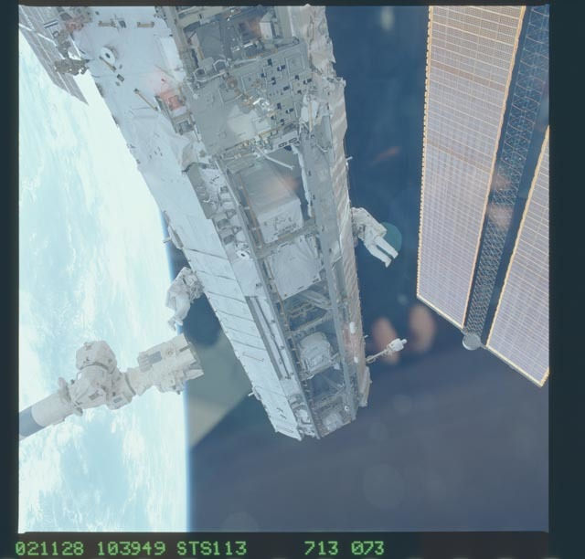 STS113-713-073 - STS-113 - Lopez-Alegria and Herrington work at the P1 truss during STS-113 EVA 2
