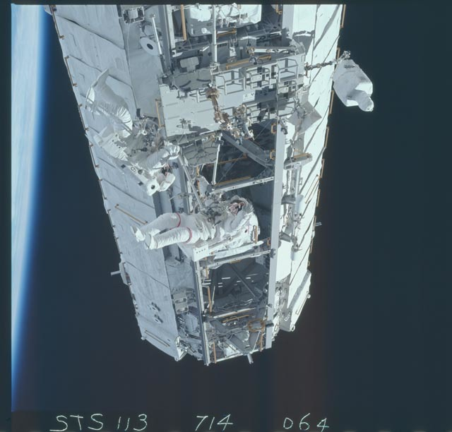 STS113-714-064 - STS-113 - Lopez-Alegria and Herrington work near CETA cart 2 during STS-113 EVA OPS