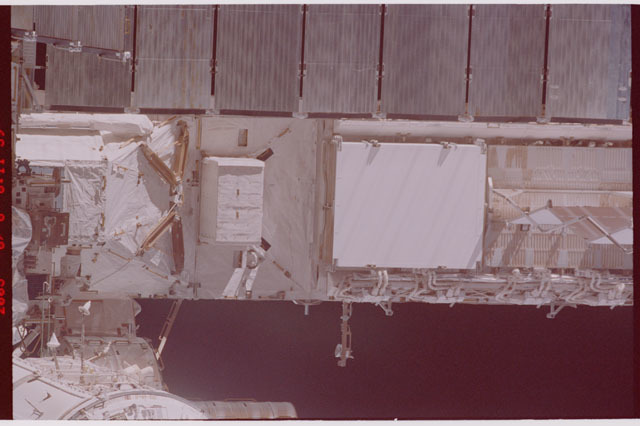 STS114-305-008 - STS-114 - Flyaround view of ISS