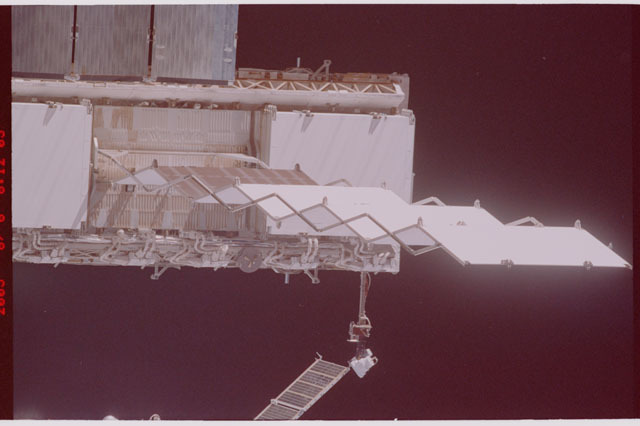STS114-305-009 - STS-114 - Flyaround view of ISS
