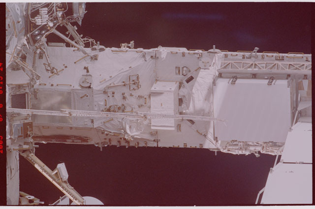 STS114-305-018 - STS-114 - Flyaround view of ISS