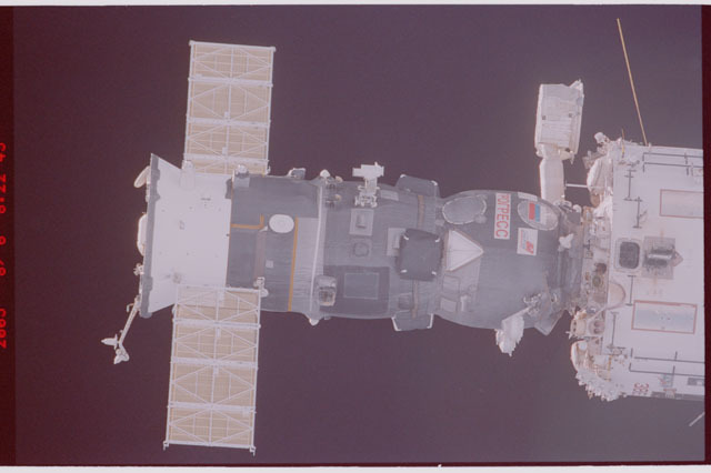 STS114-305-021 - STS-114 - Flyaround view of ISS