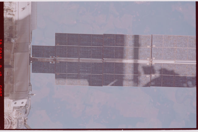 STS114-306-012 - STS-114 - Flyaround view of the ISS