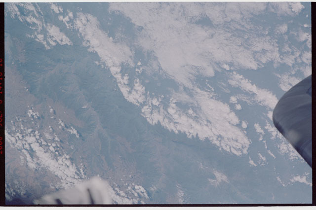 sts121-323-004 - STS-121 - Earth view of mountains taken during STS-121
