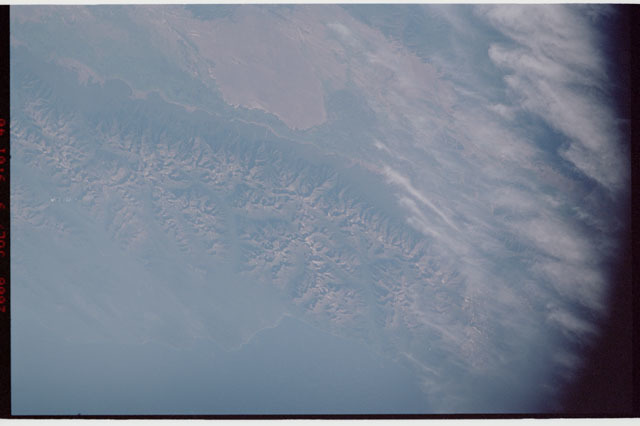 sts121-323-024 - STS-121 - Earth view of mountain range and coastline taken during STS-121