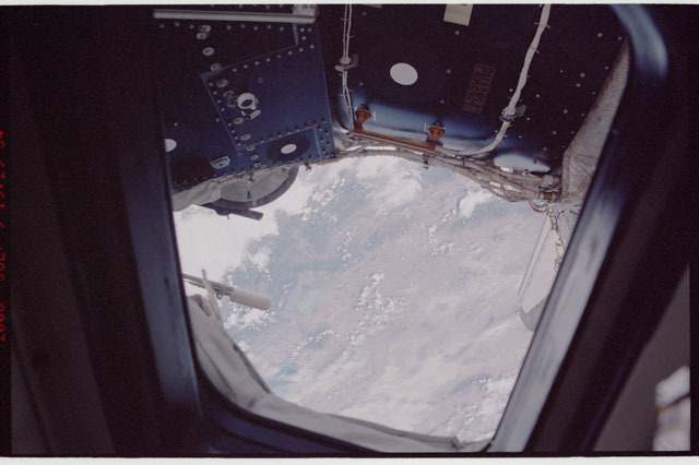 sts121-324-001 - STS-121 - View of Earth through an AFD window taken during STS-121
