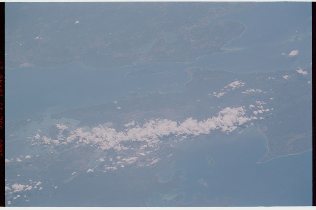 sts121-327-010 - STS-121 - Earth limb view over Michigan and the Great Lakes taken during STS-121