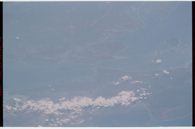 sts121-327-012 - STS-121 - Earth limb view over Michigan and the Great Lakes taken during STS-121