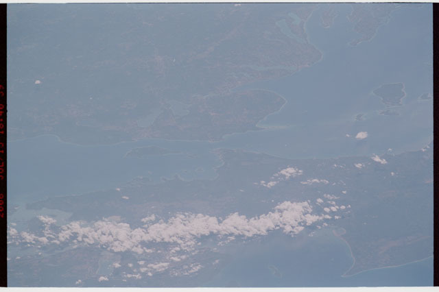 sts121-327-013 - STS-121 - Earth limb view over Michigan and the Great Lakes taken during STS-121