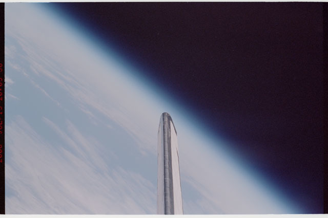 sts121-327-027 - STS-121 - Earth limb view with vertical stabilizer in foreground taken during STS-121