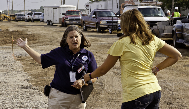 Severe Storm ^ Tornado - Joplin, Mo. , July 23, 2011 -- Susan Stonner, with FEMA External Affairs, talks with a TV reporter about work being done at one of the mobile home parks set up by FEMA for some families left homeless after the May 22 tornado.  Steve Zumwalt FEMA