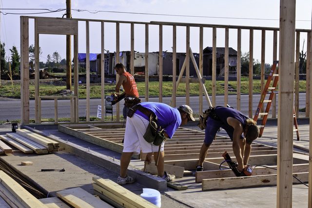 Severe Storm ^ Tornado - Joplin, Mo. , July 27, 2011 -- Builders start to rebuild a business two months after an EF-5 tornado destroyed 8000 homes and businesses. FEMA there to help with recovery efforts.  Steve Zumwalt/FEMA