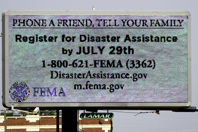 Severe Storm ^ Tornado - Joplin, Mo. , July 28, 2011 -- FEMA urges survivors  to call 1-800-621-FEMA for information on assistance programs for survivors of the tornado that struck the city of Joplin on May 22, 2011. The messages are also translated into several languages in order to alert other speaking languages communities who live in Joplin, Missouri. - Photo by: Rossyveth Rey-Berríos/FEMA