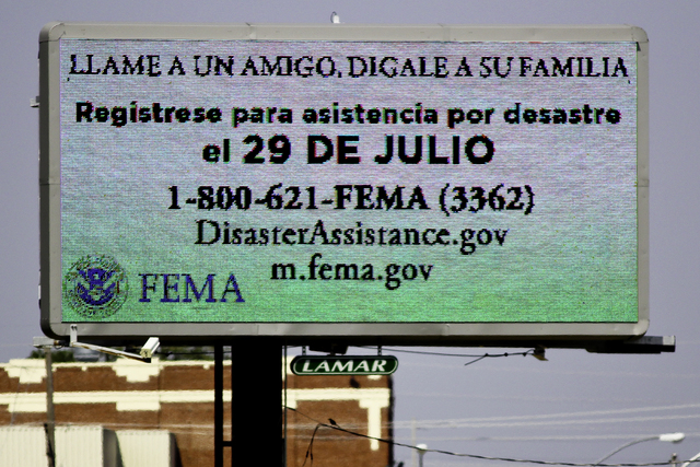 Severe Storm ^ Tornado - Joplin, Mo. , July 28, 2011 -- FEMA urges the citizens to call 1-800-621-FEMA for information on assistance programs for survivors of the tornado that struck the city of Joplin on May 22, 2011. The messages are translated into several languages; the sign above is in Spanish. - Photo by Rossyveth Rey-Berríos/FEMA
