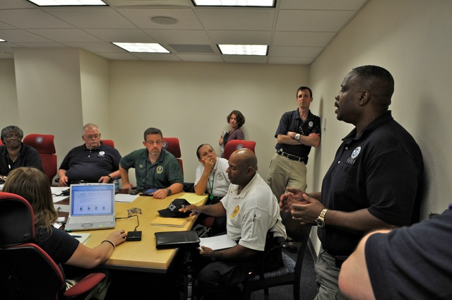 Flooding - St. Thomas, US Virgin Islands, August 2, 2011 -- Members of the FEMA Region 2 IMAT and the Virgin Islands Territorial Emergency Management Agency (VITEMA) participate in a planning meeting during the response to Tropical Storm Emily. Photo by Eliud Echevarria /FEMA