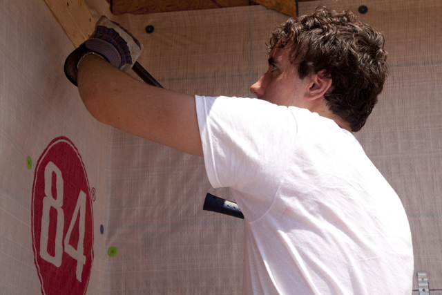 Tornado - Tuscaloosa, Ala. , August 2, 2011 -- As a volunteer for Habitat for Humanity, Jay Broughten fastens soffit and siding as he works in 100 degree heat to help rebuild homes on 5th Street in Tuscaloosa after many homes were destroyed by a series of tornados that struck Alabama on April 27. FEMA supports the generosity and expertise of volunteer agencies (VOLAGS) like Habitat for Humanity. FEMA attempts to coordinate the agency's recovery efforts through its VOLAG liaison and VOLAG specialists. Photo by Christopher Mardorf /  FEMA.