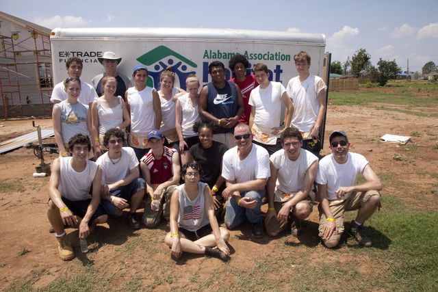 Tornado - Tuscaloosa, Ala. , August 2, 2011 -- Group photo. Habitat for Humanity volunteers work in 100 degree heat to rebuild homes on 5th Street in Tuscaloosa after they were destroyed by a series of tornados that struck Alabama on April 27. FEMA supports the generosity and expertise of volunteer agencies (VOLAGS) like Habitat for Humanity. FEMA attempts to coordinate the agency's recovery efforts through its VOLAG liaison and VOLAG specialists. Photo by Christopher Mardorf /  FEMA.