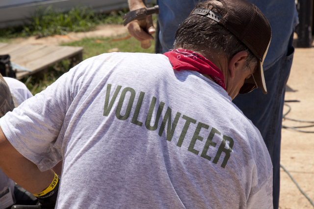 Tornado - Tuscaloosa, Ala. , August 2, 2011 -- Habitat for Humanity volunteers work in 100 degree heat to rebuild homes on 5th Street in Tuscaloosa after they were destroyed by a series of tornados that struck Alabama on April 27. FEMA supports the generosity and expertise of volunteer agencies (VOLAGS) like Habitat for Humanity. FEMA attempts to coordinate the agency's recovery efforts through its VOLAG liaison and VOLAG specialists. Photo by Christopher Mardorf /  FEMA.