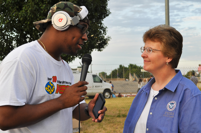 "Tornado - Joplin, Mo. , August 10, 2011 -- KSYN-FM 92. 5 on-air personality Daron ""Snacks"" Harris interviews Federal Coordinating Officer Libby Turner at the ""I AM JOPLIN"" event, a back-to-school gathering attended by thousands of school-aged children and their parents at Missouri Southern State University.  The EF-5 tornado on May 22, 2011 tore a path through Joplin seven miles long and half a mile wide. FEMA is in the city to provide assistance to the disaster survivors. Elissa Jun/FEMA"