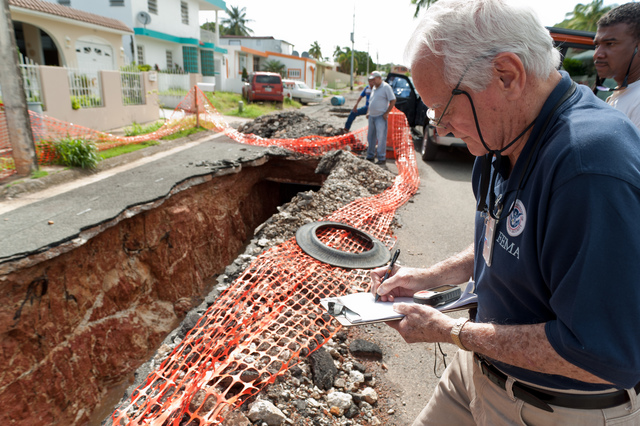 Hurricane/Tropical Storm ^ Severe Storm - Fajardo, Puerto Rico, August 25, 2011 -- Frankling Lopez inspects the damage caused by the Tropical Storm Irene for the Preliminary Damage Assessment in Fajardo. A PDA is the first step in a declaration process. Michael Medina-Latorre/FEMA