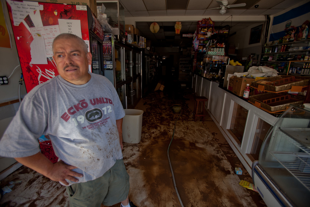 Flooding ^ Hurricane/Tropical Storm - Bound Brook, N. J. , August 29, 2011 -- Business owner, Brijo Garcia returns to cleanup his internet store after Hurricane Irene swept through the Bound Brook area. Andrea Booher/FEMA