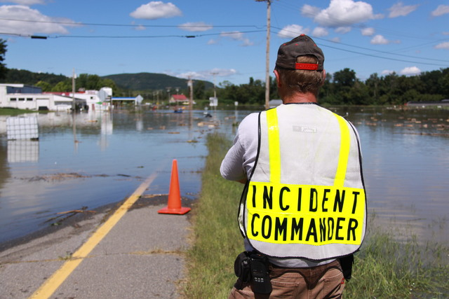 Flooding ^ Hurricane/Tropical Storm - Westminster, Vt. , August 29, 2011 -- Incident Commander and Westminster Fire Chief, Cole Streeter, observes damage caused by flash flooding following Tropical Storm Irene in the state of Vermont. FEMA provides funds to help homeowners recover from a disaster.
