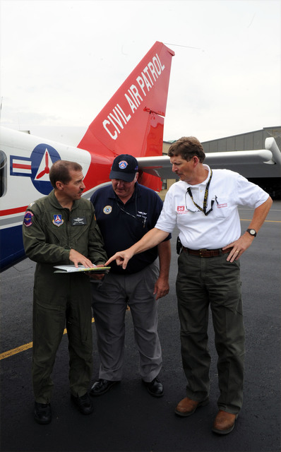 Hurricane/Tropical Storm - Hartford, Conn. , September 1, 2011 --Major Kevin Madore, a Mission Pilot for Civil Air Patrol, Left, First Lieutenant Doug Caron, Mission Scanner and US Army Corps of Engineers, Assistant Area Engineer Lamar Jenkins, go over a map regarding the flight plan to do aerial photographs and assessments.  Jocelyn Augustino/FEMA News Photo
