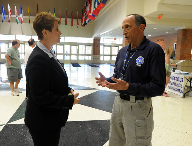 Hurricane/Tropical Storm - East Haven, Conn. , September 3, 2011 --FEMA Deputy Federal Coordinating Officer Stephen M. De Blasio, talks to Mayor April Capone during a Help Fair organized by the city, held at East Haven High School.  The state will now be receiving federal assistance due to the President declaring a major disaster declaration due to the impact of Hurricane Irene.  Jocelyn Augustino/FEMA