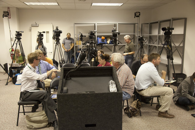 """Flooding ^ Hurricane/Tropical Storm - Neptune, N. J. , September 6, 2011 -- Media crews wait patiently after setting up their gear in a staging area at a FEMA Joint Field Office (JFO) in Neptune before a press conference hosted by New Jersey Governor Christopher James """"Chris"""" Christie. William """"Bill"""" Vogel, FEMA Federal Coordinating Officer (FCO), speaks at the press conference to update the governor and the public about the ongoing efforts of FEMA to assist the state and local governments in their response to flooding and wind damage caused by Hurricane Irene on August 28. Photo by Christopher Mardorf / FEMA."""