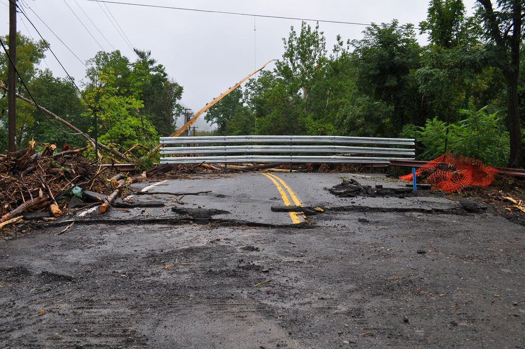 Hurricane/Tropical Storm - Phoenicia, N. Y. , September 7, 2011 -- Damaged road from south side of the bridge after Hurricane Irene passed through New York State on August 28, 2011. FEMA plays a vital role supporting State, Tribal and local governments as they respond to the impacts of Hurricane Irene. Photo by Elissa Jun/FEMA