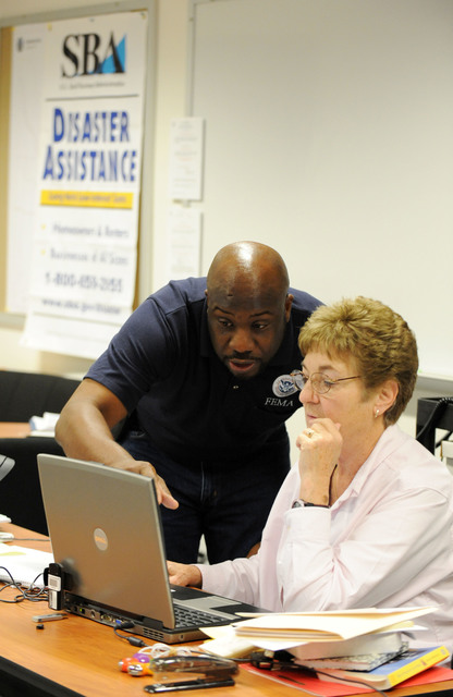 Hurricane/Tropical Storm - Torrington, Conn. , September 9, 2011 --Disaster Recovery Manager James Fumbanks, left, speaks with Applicant Services Program Specialist Patricia Ferris at the Disaster Recovery Center.  Centers have been opened up throughout the state to assist and inform residents about the process and programs available for residents impacted by Tropical Storm Irene.  Jocelyn Augustino/FEMA
