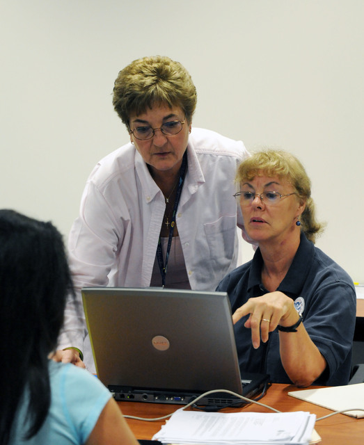 Hurricane/Tropical Storm - Torrington, Conn. , September 9, 2011 --FEMA Applicant Services Program Specialists Patricia Ferris, center and Marianne Ludwig, right, assist a resident at the Disaster Recovery Center.  Centers have been opened up throughout the state to assist and inform residents about the process and programs available for residents impacted by Tropical Storm Irene.  Jocelyn Augustino/FEMA