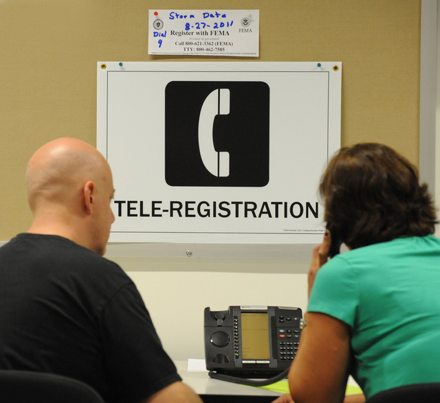 Hurricane/Tropical Storm - Torrington, Conn. , September 9, 2011 --Local residents make a call to register for FEMA assistance at a Disaster Recovery Center.  Centers have been opened up throughout the state to assist and inform residents the process and programs for residents impacted by Tropical Storm Irene.  Jocelyn Augustino/FEMA