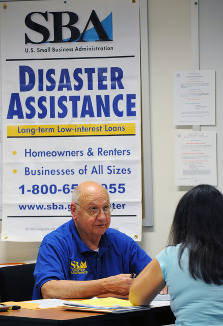 Hurricane/Tropical Storm - Torrington, Conn. , September 9, 2011 --Small Business Administration, Customer Services Representative, Homer Harris, assists a local resident at a Disaster Recovery Center.  Centers have been opened up throughout the state to assist and inform residents the process and programs for residents impacted by Tropical Storm Irene.  Jocelyn Augustino/FEMA