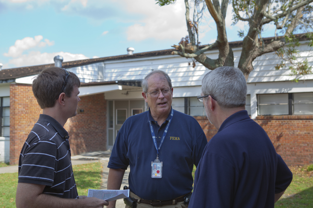 Hurricane/Tropical Storm - Swan Quarter, N. C. , September 10, 2011 -- Federal Coordinating Officer ( FCO) Mike Bolch speaks with county and state officials at the  Swan Quarter disaster Recovery Center( DRC). The FCO is appointed by the President to head federal operations in a declared disaster.  FEMA photo/Tim Burkitt