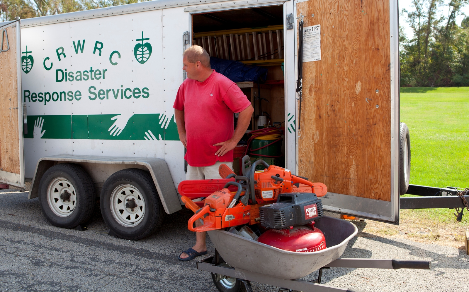 Hurricane/Tropical Storm - Swan Quarter, N. C. , September 10, 2011 -- This volunteer has traveled from Grand Rapids, Michigan to help remove downed trees for Irene survivors. Faith-based volunteer organizations are an important part of the recovery effort.  FEMA photo/Tim Burkitt