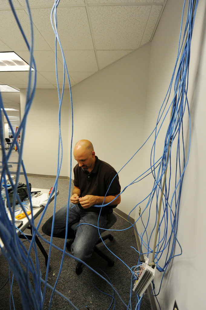 Hurricane/Tropical Storm - Windsor, Conn. , September 10, 2011 --William Geary, Mobile Emergency Response Services specialist, sets up the wiring for communications at the  Joint Field Office for the arrival of FEMA staff deployed to Tropical Storm Irene.  Jocelyn Augustino/FEMA