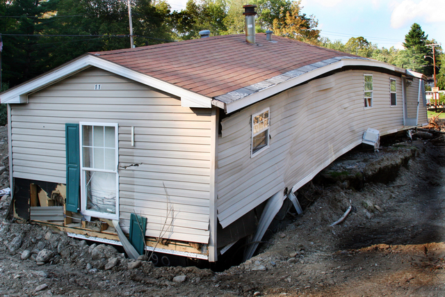 Flooding ^ Hurricane/Tropical Storm ^ Mudslide/Landslide - Pittsfield, Vt. , September 12, 2011 -- This trailer home was ripped off its foundation and broken in half by tropical storm Irene's flooding. The storm left acres of silt and debris as a result of the state wide flooding. FEMA is working to provide assistance to those who were affected by Hurricane Irene. Photo by Angela Drexel/FEMA